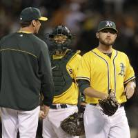 Photo -   Oakland Athletics relief pitcher Ryan Cook, right, walks to the dugout after being taken out of the game by manager Bob Melvin, left, as catcher Kurt Suzuki, center, looks on in the ninth inning of their interleague baseball game against the San Francisco Giants in Oakland, Calif., Friday, June 22, 2012. (AP Photo/Eric Risberg)