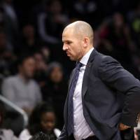 Photo - Brooklyn Nets head coach Jason Kidd paces the sideline in the second half of an NBA basketball game against the Denver Nuggets, Tuesday, Dec. 3, 2013, in New York. The Nets reassigned assistant coach Lawrence Frank to a non-bench role in which he will write daily reports and won't be at practices. (AP Photo/Kathy Willens)