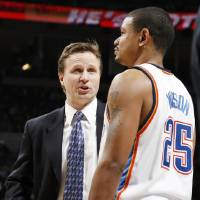 Photo - Oklahoma City head coach Scott Brooks talks to Earl Watson (25) during the NBA basketball game between the Oklahoma City Thunder and the Portland Trail Blazers at the Ford Center in Oklahoma City, Friday, February 6, 2009. The Thunder won, 102-93. BY NATE BILLINGS, THE OKLAHOMAN ORG XMIT: KOD