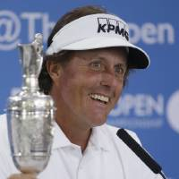 Photo - Phil Mickelson of the United States holds the Claret Jug trophy and smiles during a press conference after winning the British Open Golf Championship at Muirfield, Scotland, Sunday July 21, 2013. (AP Photo/Jon Super)