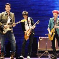 Photo - Guitarist John Mayer, left, performs with Ronnie Wood and Keith Richards, right, of The Rolling Stones at the Prudential Center in Newark, NJ on Saturday, Dec. 15, 2012. (Photo by Evan Agostini/Invision/AP)
