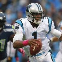Photo -   Carolina Panthers' Cam Newton (1) scrambles as Seattle Seahawks' Chris Clemons (91) chases during the second quarter of an NFL football game in Charlotte, N.C., Sunday, Oct. 7, 2012. (AP Photo/Bob Leverone)