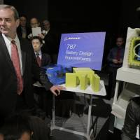 Photo - Boeing Commercial Airplanes Vice President and Chief Project Engineer Mike Sinnett poses with a model of newly designed 787's battery during a news conference in Tokyo, Friday, March 15, 2013. Boeing executives said commercial flights of its grounded 787 jets will resume