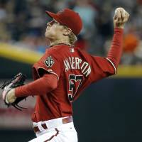 Photo - Arizona Diamondbacks pitcher Chase Anderson throws against the Atlanta Braves during the first inning of a baseball game, Sunday, June 8, 2014, in Phoenix. I (AP Photo/Matt York)