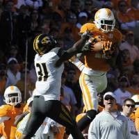 Photo -   Tennessee wide receiver Justin Hunter (11) makes a catch over Missouri defensive back E.J. Gaines (31) during the first quarter during an NCAA football game at Neyland Stadium, Saturday, Nov. 10, 2012, in Knoxville, Tenn. (AP Photo/Knoxville News Sentinel, Amy Smotherman Burgess)