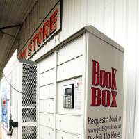 Photo - Norman city council members say this book drop box at the B&B Country Store on E Alameda Street is inadequate to meet the needs of eastside residents. PHOTO BY STEVE SISNEY, THE OKLAHOMAN