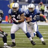 Photo - Former OSU standout Charlie Johnson has been leading the way for Colts like Dallas Clark (right) since 2006. AP ARCHIVE PHOTO