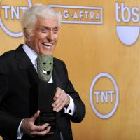 Photo - Actor Dick Van Dyke poses backstage with his life achievement award at the 19th Annual Screen Actors Guild Awards at the Shrine Auditorium in Los Angeles on Sunday, Jan. 27, 2013. (Photo by Chris Pizzello/Invision/AP)
