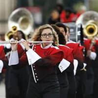 Photo - Del City High School's marching band performs the school fight song in the Del City High School  homecoming parade.   Photo by Jim Beckel,  The Oklahoman.