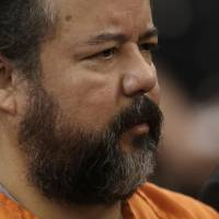 Photo - FILE-In this Wednesday, July 17, 2013, file photo shows Ariel Castro standing before a judge during his arraignment in Cleveland.  Several media outlets in Cleveland reported Thursday, July 25, 2013, that a deal has been offered to resolve the case against 53-year-old Castro. The prosecutor's office declined comment. (AP Photo/Tony Dejak, File)