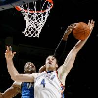 Photo - Orlando's Dwight Howard blocks the shot of Oklahoma City's Nick Collison during the NBA basketball game between the Oklahoma City Thunder and the Orlando Magic at the Ford Center in Oklahoma City, Wednesday, Nov. 12, 2008. BY BRYAN TERRY, THE OKLAHOMAN   ORG XMIT: KOD