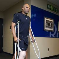 Photo -   New York Yankees pitcher Mariano Rivera steps outside the clubhouse before a baseball game against the Kansas City Royals in Kansas City, Mo., Friday, May 4, 2012. Rivera tore the anterior cruciate ligament and damaged the meniscus in his right knee while shagging fly balls during batting practice Thursday. (AP Photo/The Kansas City Star, John Sleezer)