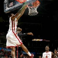 Photo - OU's Cameron Clark dunks the ball over Cincinnati's Yancy Gates as Andrew Fitzgerald watches during the All-College Classic basketball game between the University of Oklahoma and Cincinnati at the Oklahoma City Arena on Saturday, December 18,  2010.   Photo by Bryan Terry, The Oklahoman