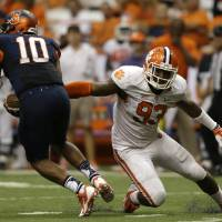 Photo - Clemson defensive end Corey Crawford (93) pressures Syracuse quarterback Terrell Hunt (10) during the second half of an NCAA college football game on Saturday, Oct. 5, 2013, in Syracuse, N.Y. Clemson won, 49-14. (AP Photo/Mike Groll)