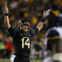 Photo - Baylor quarterback Bryce Petty (14), holds up his hands after a touchdown against West Virginia during the first half of an NCAA college football game on Saturday, Oct.  5, 2013, in Waco, Texas.  (AP Photo/Rod Aydelotte)