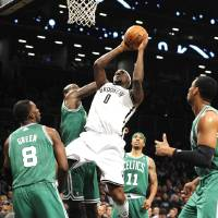 Photo -   Brooklyn Nets' Andray Blatche (0) shoots around Boston Celtics' Jeff Green (8), Kevin Garnett (5), Courtney Lee (11) and Jared Sullinger, right, during the first half of an NBA basketball game on Thursday, Nov., 15, 2012, at Barclays Center in New York. (AP Photo/Kathy Kmonicek)