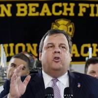 Photo - New Jersey Gov. Chris Christie addresses a gathering of residents and others in Union Beach, N.J., Tuesday, Feb. 5, 2013. Christie said Tuesday the National Flood Insurance Program's handling of claims in New Jersey