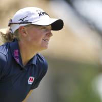Photo - Stacy Lewis watches her ball from the third tee box during the final round of the LPGA NW Arkansas Championship golf tournament on Sunday, June 23, 2013, in Rogers, Ark. (AP Photo/Beth Hall)