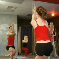 Photo - Kelly Hacker and others participate in a Bikram (hot) Yoga class at 6710 N Classen in Oklahoma City, Okla., Saturday, February 24, 2007. Photo by Paul Hellstern / The Oklahoman. ORG XMIT: KOD
