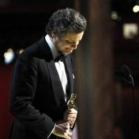 """Photo -  Colin Firth accepts the best actor award for """"The King's Speech."""""""