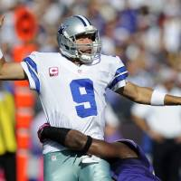 Photo -   Dallas Cowboys quarterback Tony Romo reacts as he is tackled by Baltimore Ravens outside linebacker Courtney Upshaw in the second half of an NFL football game in Baltimore, Sunday, Oct. 14, 2012. (AP Photo/Nick Wass)