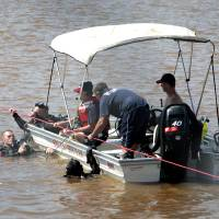 Photo - Oklahoma City Fire Department divers search for a victim of the May 31st storms in the Oklahoma River near May Avenue, Friday  , June 21, 2013. Photo by David McDaniel, The Oklahoman