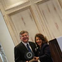Photo - Ron Key, vice president of The Linde Group, which has a gas processing plant in Tulsa, accepts the Compass Award for midsized companies from OK Ethics director Shannon Warren. PHOTO PROVIDED