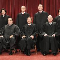 Photo - The  justices of the U.S. Supreme Court . AP FILE PHOTO