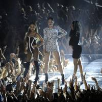 Photo - Ariana Grande, from left, Jessie J and Nicki Minaj perform at the MTV Video Music Awards at The Forum on Sunday, Aug. 24, 2014, in Inglewood, Calif. (Photo by Chris Pizzello/Invision/AP)