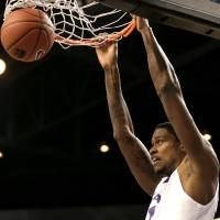 Photo - Kansas State forward Jordan Henriquez dunks during the first half of an NCAA college basketball game against Texas Southern on Tuesday, Dec. 18, 2012, in Manhattan, Kan. (AP Photo/Charlie Riedel)