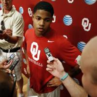 Photo - Wide Receiver Sterling Shepard speaks with reporters during the University of Oklahoma (OU)  football team's media day in the Adrian Peterson Team Meeting Room on Saturday, Aug. 2, 2014 in Norman, Okla.  Photo by Steve Sisney, The Oklahoman