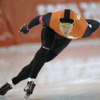 Photo - Stefan Groothuis of the Netherlands competes in the men's 1,000-meter speedskating race at the Adler Arena Skating Center during the 2014 Winter Olympics in Sochi, Russia, Wednesday, Feb. 12, 2014. (AP Photo/Pavel Golovkin)