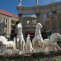 Photo - Statues of a Roman centurion and horses greet visitors to Caesars Atlantic City, shown here in Atlantic City N.J. on Oct. 3, 2011. Caesars Entertainment is expected to be a major player in the Internet gambling market, which is shaping up as a competition between Nevada and New Jersey, both of which have recently approved online gambling laws. (AP Photo/Wayne Parry)