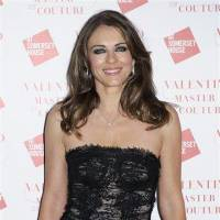 Photo - Elizabeth Hurley arrives for the Valentino Master of Couture Party on Wednesday, Nov. 28, 2012, in London. (Photo by Jonathan Short/Invision/AP)