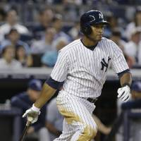 Photo - New York Yankees' Zoilo Almonte hits a single during the fourth inning of a baseball game against the Tampa Bay Rays, Friday, June 21, 2013, in New York. (AP Photo/Frank Franklin II)