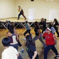 Photo - Instructor Jose Munoz leads a Zumba marathon at the