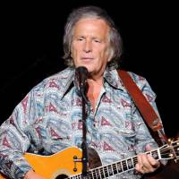 Photo - In this Juy 3, 2012 file photo provided by the Las Vegas News Bureau, Don McLean performs at the  Las Vegas Hotel and Casino in Las Vegas. McLean has been fined $400 for driving his Chrysler too fast through a school zone in Maine and has paid the levy. He had contested the charge in September, saying school zone warning lights weren't flashing. He had requested a trial. Police said during a 40-minute proceeding in Rockland District Court on Thursday, Jan. 24, 2013, the warning lights were flashing. Judge Patricia Worth found McLean had been speeding in a school zone in Rockport. But she lowered what would be a $515 fine if uncontested to $400. McLean immediately paid up. McLean lives in nearby Camden, along Maine's coast.  (Photo/Las Vegas News Bureau, Darrin Bush)