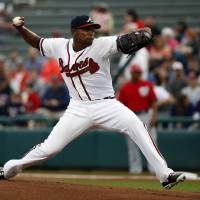 Photo - Atlanta Braves starting pitcher Julio Teheran (49) throws in the first inning of a spring exhibition baseball game against the Washington Nationals, Thursday, March 6, 2014, in Kissimmee, Fla. (AP Photo/Alex Brandon)
