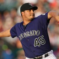 Photo - Colorado Rockies starting pitcher Jhoulys Chacin works against the St. Louis Cardinals in the fourth inning of a baseball game in Denver on Monday, June 23, 2014. (AP Photo/David Zalubowski)