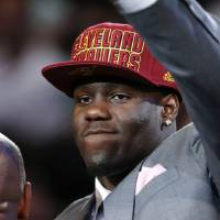 Photo - UNLV's Anthony Bennett waves after being selected first overall by the Cleveland Cavaliers in the NBA basketball draft, Thursday, June 27, 2013, in New York. (AP Photo/Jason DeCrow)