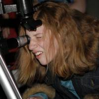 Photo - Sarah Lenkem, 13, of Norman, looks through a telescope during a star gazing session outside of the Sam Noble Oklahoma Museum of Natural History on April 2, 2009, in Norman, Okla. BY BRENDA O'BRIAN, THE OKLAHOMAN ORG XMIT: KOD
