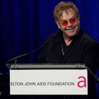 Photo -   Elton John appears on stage at his AIDS Foundation's 11th annual Enduring Vision benefit on Monday, Oct. 15, 2012 in New York. (Photo by Charles Sykes/Invision/AP)