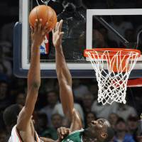 Photo - Boston's Kendrick Perkins blocks the shot of Oklahoma City's Kevin Durant in the second half during the NBA basketball game between the Oklahoma City Thunder and the Boston Celtics at the Ford Center in Oklahoma City, Wednesday, Nov. 5, 2008. Boston won, 96-83. BY NATE BILLINGS, THE OKLAHOMAN ORG XMIT: KOD