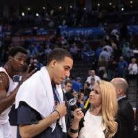 Photo - Thunder sideline reporter Lesley McCaslin, right, interviews Kevin Martin after a game. Photo provided
