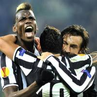 Photo - Juventus midfielder Paul Pogba, of France, celebrates after scoring with teammates Andrea Pirlo, right, and Carlos Tevez, center, during the Europa League, round of 16th, soccer match between Juventus and Trabzonspor at the Juventus stadium, in Turin, Italy, Thursday, Feb. 20, 2014. (AP Photo/Massimo Pinca)