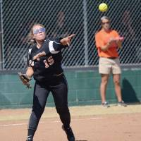 Photo -  Taylor Faulkenberry tosses a runner out during Lexington's district championship finale. (Purcell Register photo)