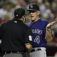 Photo -   Colorado Rockies manager Jim Tracy (4) argues with umpire Mark Ripperger after thinking that Andrew Brown was hit by a pitch during the eighth inning of a baseball game against the Arizona Diamondbacks, Wednesday, Oct. 3, 2012, in Phoenix. The Rockies defeated the Diamondbacks 2-1. (AP Photo/Ross D. Franklin)