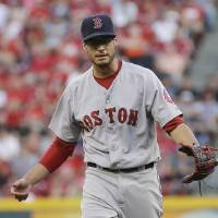 Photo - Boston Red Sox  pitcher Joe Kelly reacts after striking out Cincinnati Reds Chris Heisey in the first inning of a baseball game, Tuesday, Aug. 12, 2014, in Cincinnati. (AP Photo/Tony Tribble)