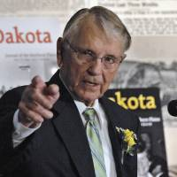 Photo - FILE - In this April 30, 2010 file photo, former North Dakota Gov. George Sinner speaks at an event in his honor in Bismarck, N.D. Sinner, a Casselton native, wants new regulations placed upon railroads that transport crude oil from the state. He says the derailment of tanker cars and ensuing fire outside Casselton on Dec. 30, 2013, shows what he calls a