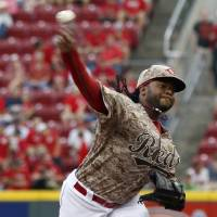 Photo - Cincinnati Reds starting pitcher Johnny Cueto throws against the Los Angeles Dodgers during the first inning of a baseball game, Wednesday, June 11, 2014, in Cincinnati. (AP Photo/David Kohl)